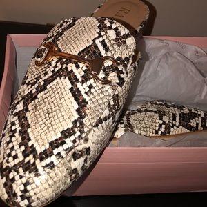 Brand new never worn snake print mule slippers.
